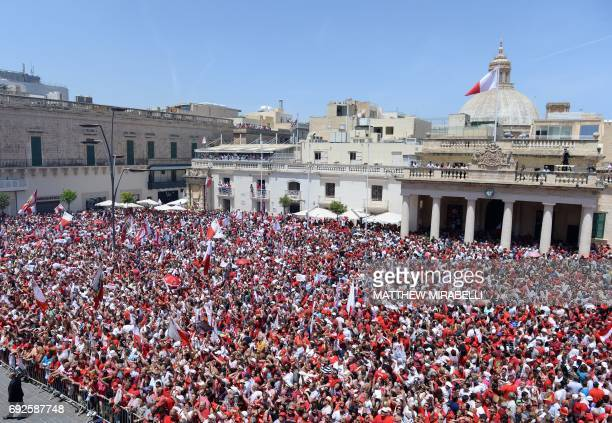 Labour Party supporters gather as they wait to greet Joseph Muscat after his swearing in ceremony as Prime Minister of Malta at The Palace of the...