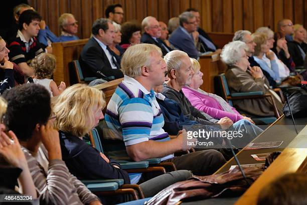 Labour Party supporters listen to the Shadow Health Secretary and Labour leadership hopeful Andy Burnham during a question and answer session at the...