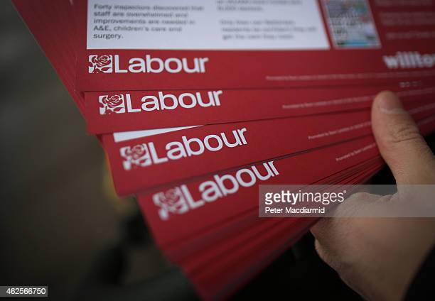 Labour Party worker shows leaflets for distribution as he canvasses for votes in Battersea on January 31 2015 in south London England Campaigning for...