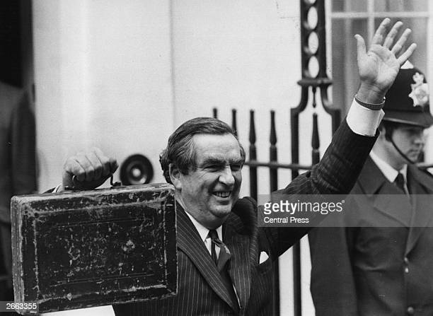 Labour politician and Chancellor of the Exchequer Denis Healey holds up the budget box for all to see Original Publication People Disc HE0133