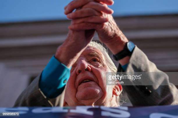 Labour politician and Member of Parliament for Bolsover Dennis Skinner on the balcony of the County Hotel watches colliery bands pass below during...