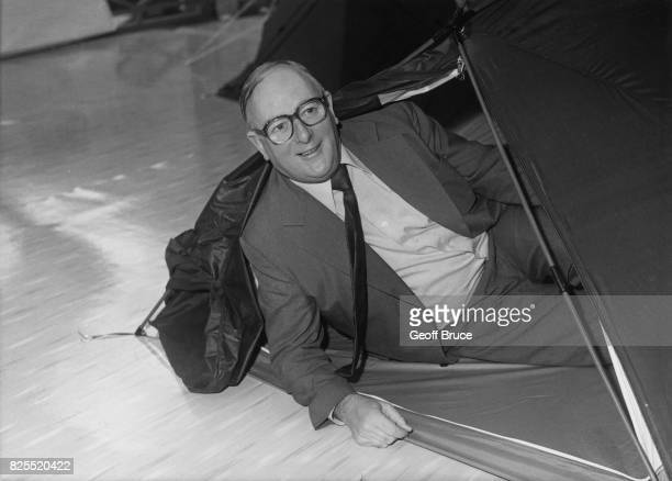 Labour politician Denis Howell the former Minister of State for Sport tries out a tent after opening the 22nd annual Camping and Outdoor Leisure...