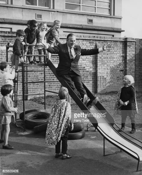 Labour politician Denis Howell the Minister of State for Sport and Parliamentary UnderSecretary of State for Education tries out a slide after...