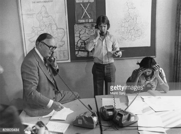 Labour politician Denis Howell the Minister of State for Sport and temporary Minister of State for Drought fields calls in the operations room at his...