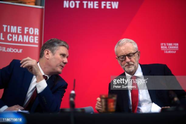 Labour politician Keir Starmer and Labour leader Jeremy Corbyn talk onstage during a campaign speech on December 6 2019 in London England Mr Corbyn...