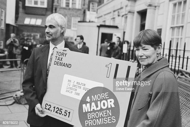 Labour Shadow Chief Secretary to the Treasury, Alistair Darling, and MP Glenda Jackson, hold an outsize tax bill for Prime Minister John Major,...