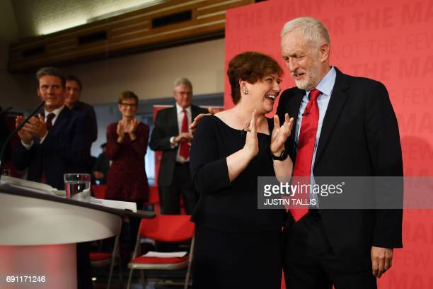 Labour Shadow Foreign Secretary Emily Thornberry and Labour Party leader Jeremy Corbyn clap during an election campaign event in Basildon east of...