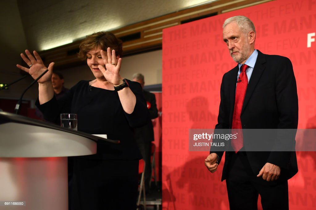 Labour Shadow Foreign Secretary Emily Thornberry (L) warms up the crowd before Labour Party leader Jeremy Corbyn speaks during an election campaign event in Basildon, east of London on June 1, 2017. / AFP PHOTO / Justin TALLIS