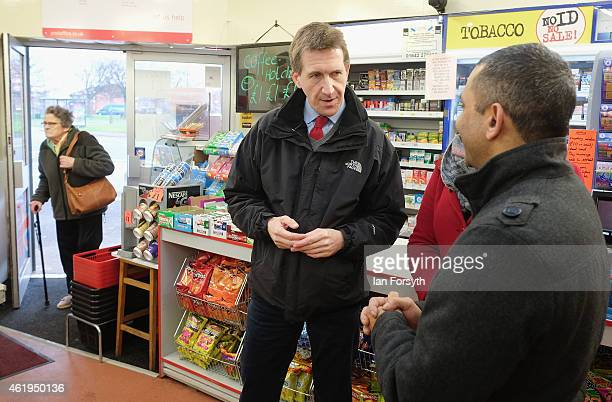 Labour shadow Justice Minister Dan Jarvis chats to the owner of a convenience store during a visit on January 22 2015 in Redcar England The visit...