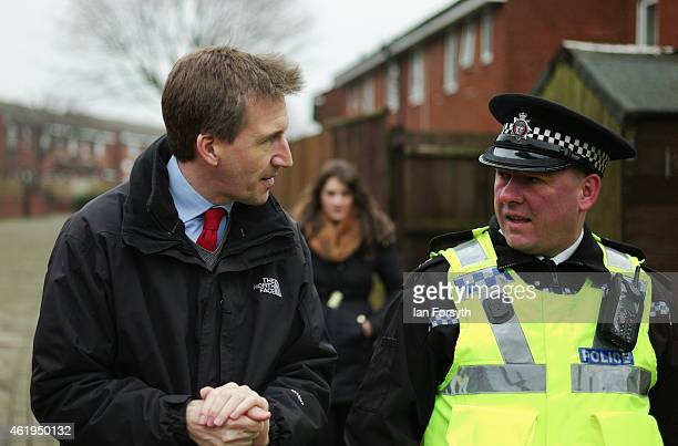 Labour shadow Justice Minister Dan Jarvis speaks with Chief Inspector Jason Dickson during a visit on January 22 2015 in Redcar England The visit...