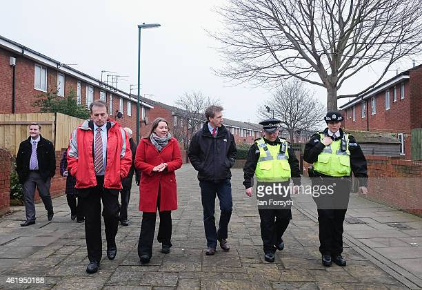 Labour shadow Justice Minister Dan Jarvis speaks with Chief Inspector Jason Dickson and Inspector Emily Harrison during a visit on January 22 2015 in...