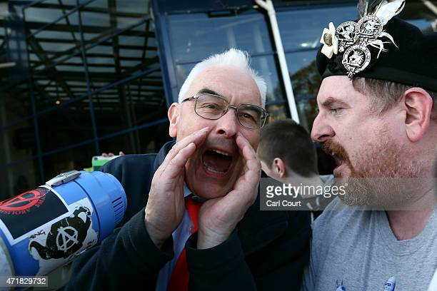 Labour supporter shouts over a Scottish Independence protester as they demonstrate ahead of the arrival of Labour leader Ed Miliband for a campaign...