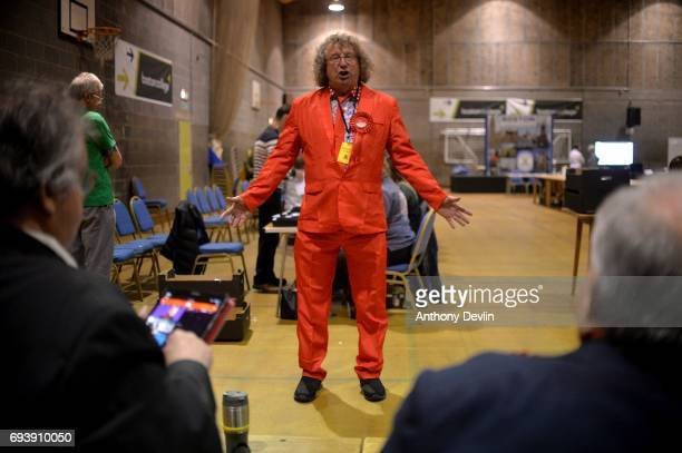 Labour supporter wears a red suit at the Peter Paine Performance Centre where the vote count for the constituency of Boston and Skegness is underway...