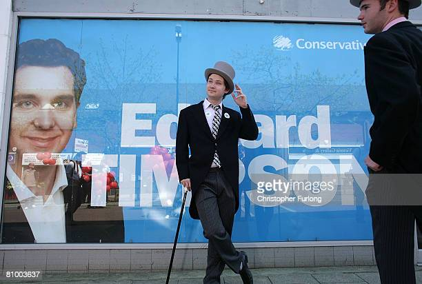 Labour supporters dressed as 'Tory Toffs' stand outside the office of conservative parlimentary candidate Edward Timpson before the arrival of Leader...