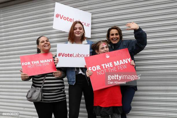 Labour supporters hold banners ahead of a speech by Jeremy Corbyn Leader of the Labour Party at a campaign rally at the Belmont Circle on June 7 2017...
