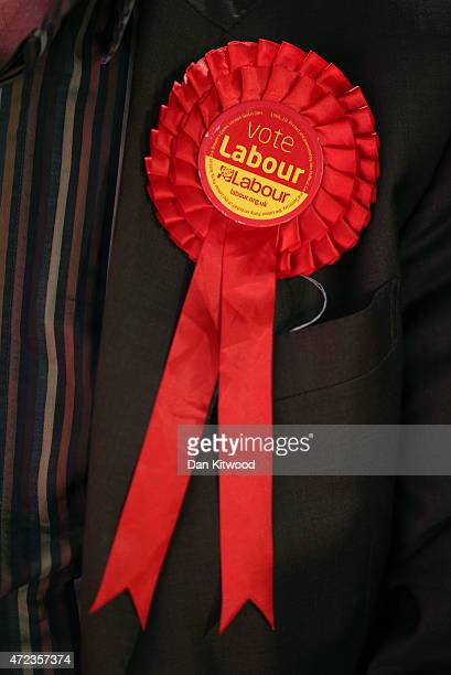 Labour supporters rosette ahead of Labour leader Ed Miliband speaking at a campaign rally at Leeds City Museum on May 6 2015 in Leeds England...