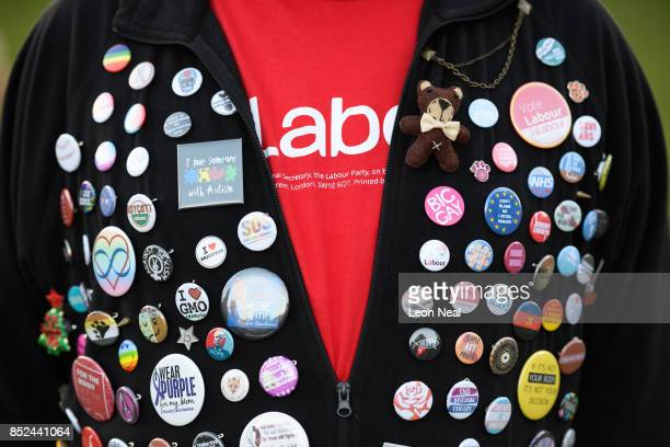 Labour supporters shows off his collection of badges ahead of a speech by Labour Party leader Jeremy Corbyn at a Momentum rally on September 23 2017...