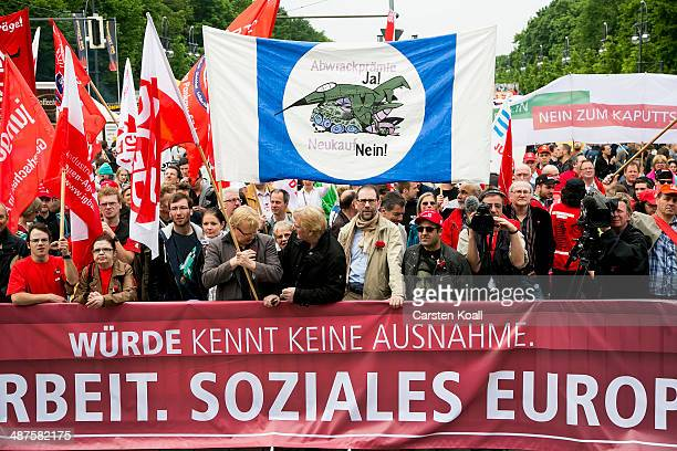 Labour union members congregate in front of the Brandenburg Gate after marching through the city center on May 1 2014 in Berlin Germany May Day the...