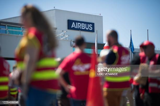 Labour union members gather in front of the civil aircraft manufacturing company Airbus on July 8, 2020 in Montoir-de-Bretagne, western France, to...