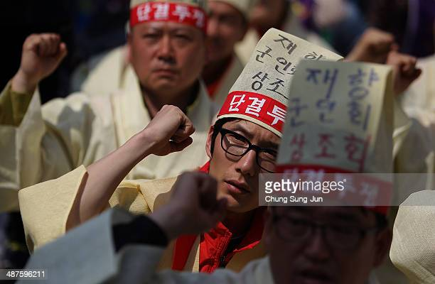 Labour union members participate in a May Day rally organized by the Korean Confederation of Trade Unions at the Seoul Railway Station on May 1 2014...