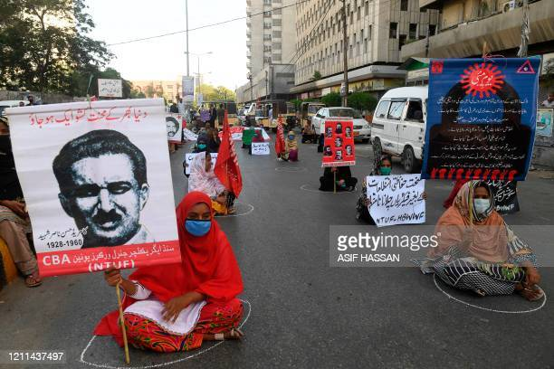 TOPSHOT Labour union workers maintain social distancing as they carry placards during a May Day rally in Karachi on May 1 2020