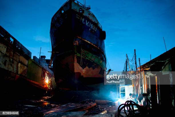 Labour works in a dockyard in the side of Buriganga River at Dhaka August 2 2017 The laborers work in the dockyard without proper safety measures and...