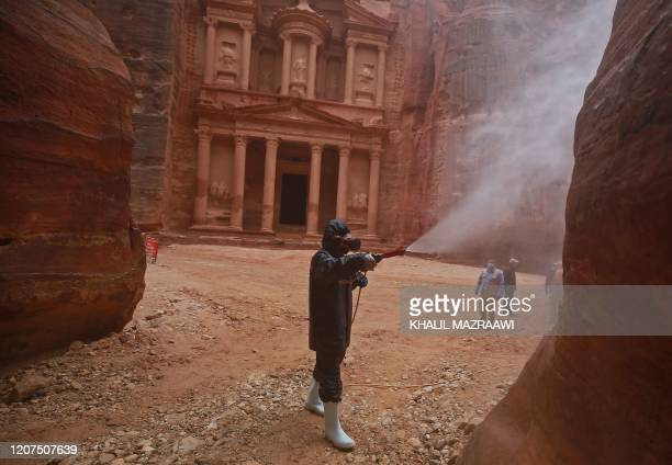 Labourer sprays disinfectant in Jordan's archaeological city of Petra south of the capital Amman on March 17 to prevent the spread of COVID-19.