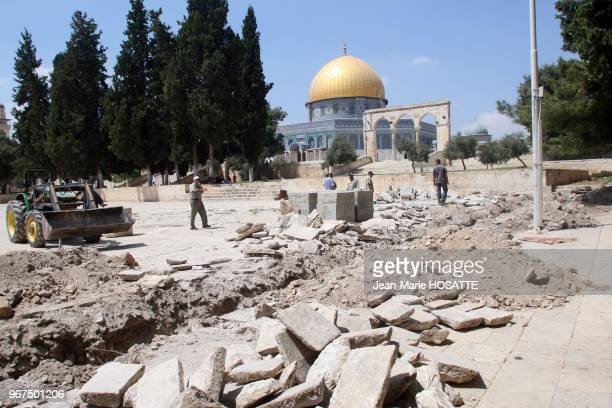 A labourer stands near an excavator on the plaza near the Dome of the Rock Mosque in Jerusalem's Old City August 30 2007 Israeli archaeologists said...
