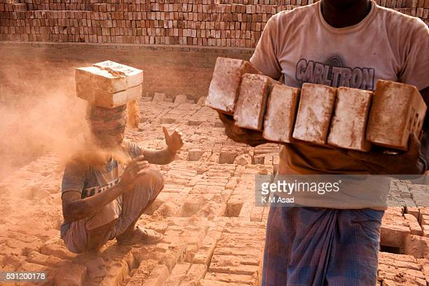 A labourer working in a brickfield covered with thick dust in Dhaka Bangladesh December 10 2015 In this brickfield burning coal causes tremendous...