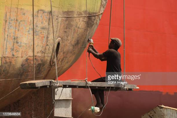 Labourer working on a ship at a breaking yard at keraniganj during the coronavirus crisis. Following the relaxation of covid-19 restrictions,...