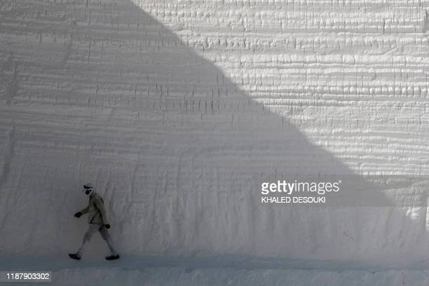 A labourer works at the White Mountain limestone extraction quarry site near Egypt's southern city of Minya some 265 kilometres south of the capital...