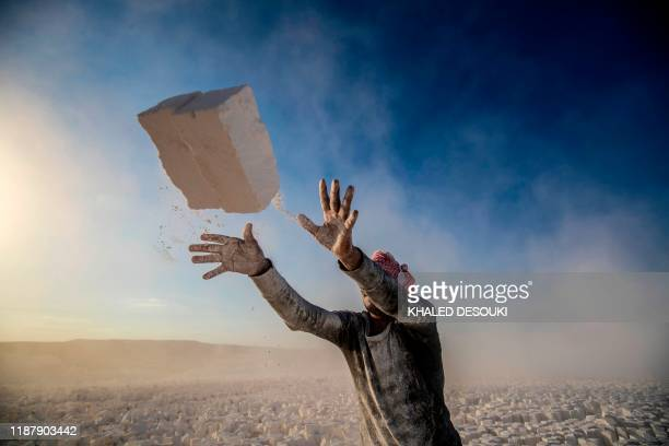 TOPSHOT A labourer works at the White Mountain limestone extraction quarry site near Egypt's southern city of Minya some 265 kilometres south of the...