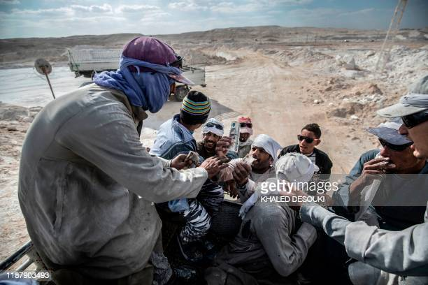 TOPSHOT Labourers are pictured at the White Mountain limestone extraction quarry site near Egypt's southern city of Minya some 265 kilometres south...