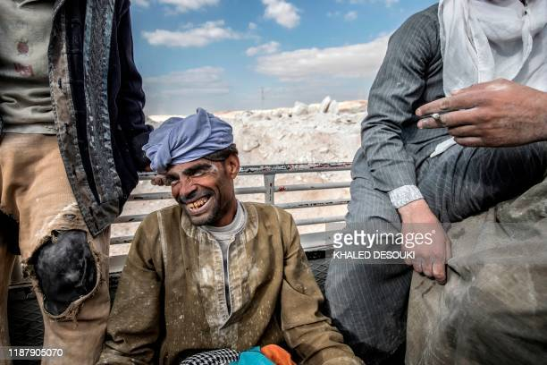 Labourers are pictured at the White Mountain limestone extraction quarry site near Egypt's southern city of Minya some 265 kilometres south of the...