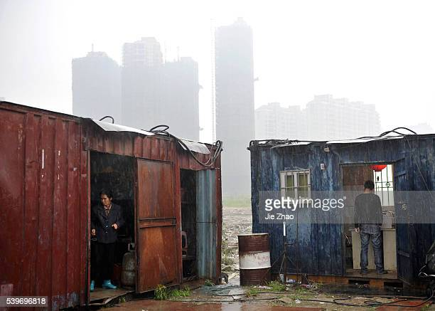 Labourers are seen at their temporary dormitory made from containers in Fuzhou, Fujian province April 11, 2010. VCP