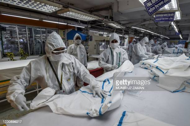 Labourers fromBeximco TextilesLtdmanufacturerwork on Personal Protective Equipment garment used as a preventive measure against the COVID-19...