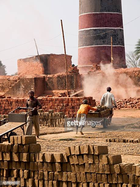 Labourers in poor working conditions at a Bangladesh Brick factory