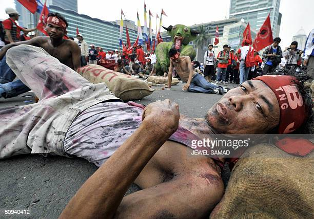 Labourers mimic a scene of being tortured during a demonstration to mark May Day in Jakarta on May 1 2008 Labourers transsexuals gays students...
