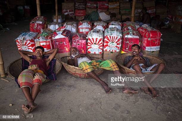 Labourers of Karwan Bazar break for a midday siesta to beat the hot summer noon in their workplace at Karwan Bazaar on May 12 2016 in Dhaka...