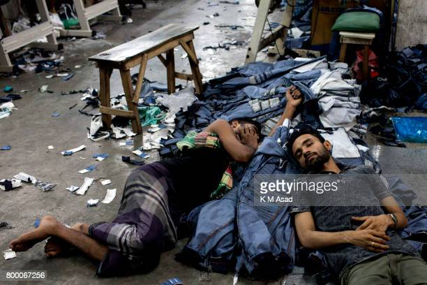 SADARGHAT DHAKA BANGLADESH Labourers sleep over the denim jeans in a local denim garments shop in Dhaka