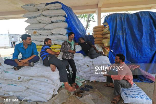 Labourers talks each others at Kukar Kheda Grain Market following the announcement of 4 days strike by Rajasthan Khadya Padarth Vypar Sangh against...