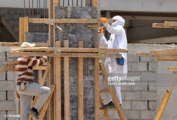 Labourers work at a construction site in the Saudi capital Riyadh on June 6 as lockdown measures are eased amid the COVID-19 pandemic.