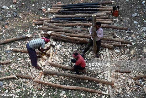 Labourers work at New Road contraction at howrah district around 16 kms West of Kolkata on January 152018 in KolkataIndia