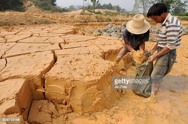Labourers work at the site of a rare earth metals mine at Nancheng county Jiangxi province October 7 2010 China on Wednesday denied a report that the...