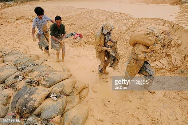 Labourers work at the site of a rare earth metals mine at Nancheng county Jiangxi province October 20 2010 China on Wednesday denied a report that...