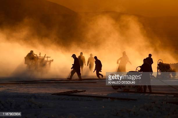 """Labourers work at the """"White Mountain"""" limestone extraction quarry site near Egypt's southern city of Minya, some 265 kilometres south of the..."""