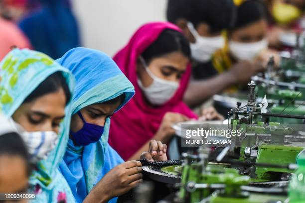 Labourers work in a garment factory during a government-imposed lockdown as a preventative measure against the spread of the COVID-19 coronavirus in...