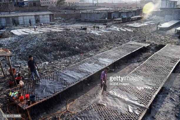 Labourers working at a tannery factory in Hazaribagh. The Leather industry is a major industry in Bangladesh and the Government of Bangladesh has...