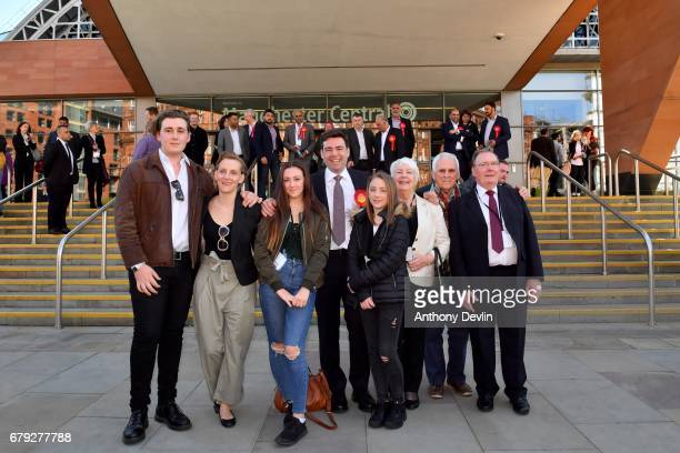 Labour's Andy Burnham celebrates winning the Greater Manchester mayoral election with son Jimmy wife MarieFrance van Heel daughter Rosie and daughter...