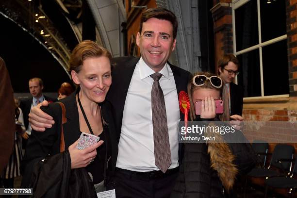 Labour's Andy Burnham celebrates winning the Greater Manchester mayoral election with wife MarieFrance van Heel L and daughter Annie at Manchester...